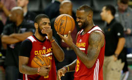 LeBron James and Kyrie Irving share a laugh.