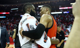 James Harden and Russell Westbrook embrace after a game.
