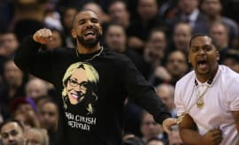 Drake wearing a Doris Burke shirt.