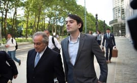 Ex-pharmaceutical executive Martin Shkreli leaves with his lawyer Benjamin Brafman
