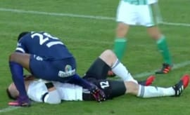 Soccer player saves opponent's life.