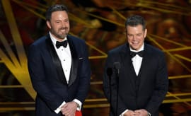 Ben Affleck (L) and Matt Damon speak onstage during the 89th Annual Academy Awards