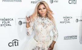 Rapper Lil' Kim attends the 'Can't Stop, Won't Stop: The Bad Boy Story' Premiere