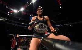 Amanda Nunes celebrates her victory over Ronda Rousey.