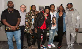 The members of Migos and their Quality Control team celebrate signing with Motown.