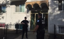 Montreal Police guard the front of the four storey building in Montreal