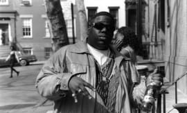 Biggie holds a bottle of St. Ides