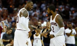 LeBron James yells at Kyrie Irving.