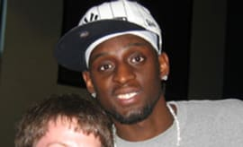 Darius Miles poses with a fan.