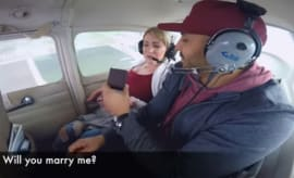 Man throws up during plane proposal.