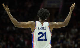 Joel Embiid motions for 76ers fans to get off their seats.