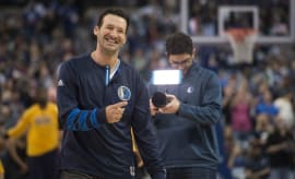 Tony Romo smiles in the Mavericks' layup line.