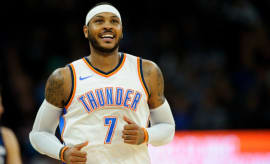 Carmelo Anthony reacts to a call.