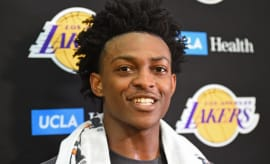De'Aaron Fox answers questions after working out for the Lakers.