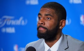 Kyrie Irving addresses reporters after NBA Finals game.