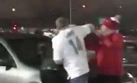 Jets and Dolphins fans get into fight at parking lot.
