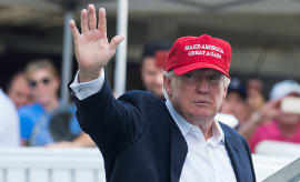 US President Donald Trump waves to well wishers