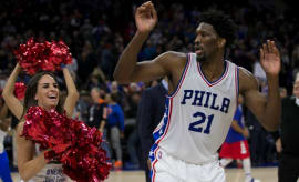 Joel Embiid dances with a 76ers cheerleader.