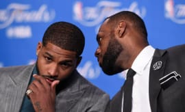 LeBron James whispers to Tristan Thompson at a 2016 NBA Finals press conference.