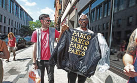 Jon Sherman, left, and Kobla Hargett, of Boston, showed off their merchandise.