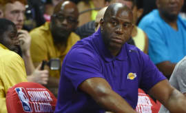 Magic Johnson watches the Lakers at NBA Summer League.