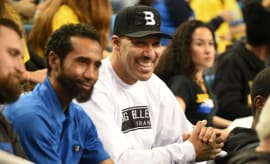 LaVar Ball watches a UCLA game in Big Baller Brand gear.