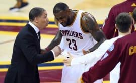 LeBron James and Tyronn Lue talk during an NBA Finals game.