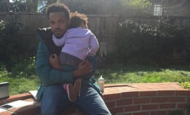 Chance the Rapper holds his daughter for an Instagram shot.