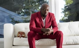 Wyclef red suit