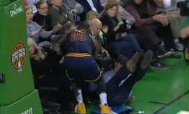 LeBron James nearly collides with Bill Belichick.