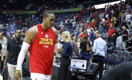 Dwight Howard walks off court after Hawks eliminated from playoffs.