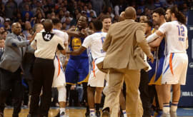Warriors and Thunder players scuffle.