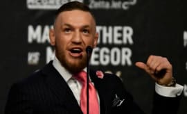 Conor McGregor speaks during a press conference with Floyd Mayweather.