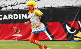 Arizona Cardinals quarterback Carson Palmer wears clown suit during warmups