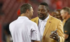 Warren Sapp (R) talks to former teammate John Lynch (L).