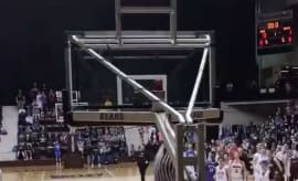 High school basketball referee shuts down gym with dunk.