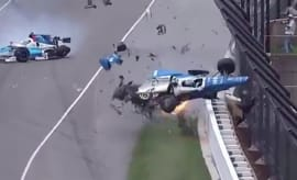 Driver collides into fence at Indianapolis 500.