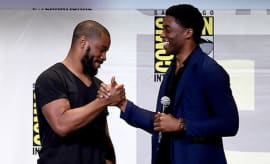 Ryan Coogler and Chadwick Boseman dap up one another.