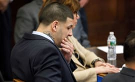 Aaron Hernandez sits at the defense table during jury deliberations in his double murder trial.