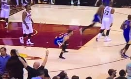 Stephen Curry may (or may not) be pretending to poop on the Cavs' court here.