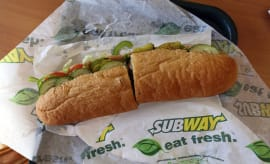 A Subway sandwich is seen in a restaurant