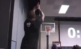 Isaiah Thomas takes part in a shooting contest at Seahawks' training camp.