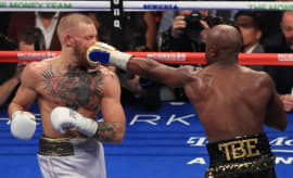 Conor McGregor getting punched in the face by Floyd Mayweather
