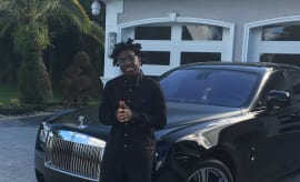 This is Kodak Black's Instagram selfie with a Rolls Royce.
