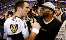 Joe Flacco and Ray Lewis exchange words after winning the Super Bowl.