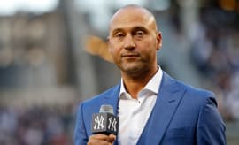 Derek Jeter speaks after being honored during a pre-game ceremony to retire his jersey number.