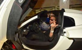 Quavo sits in a car.