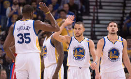 Stephen Curry high-fives Kevin Durant.