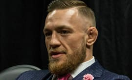 "Conor McGregor's ""F*CK YOU"" pinstripe suit"