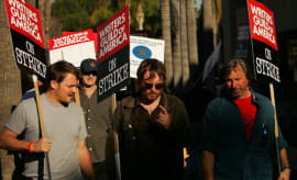 Writers Guild of America members and supporters picket in front of NBC studios